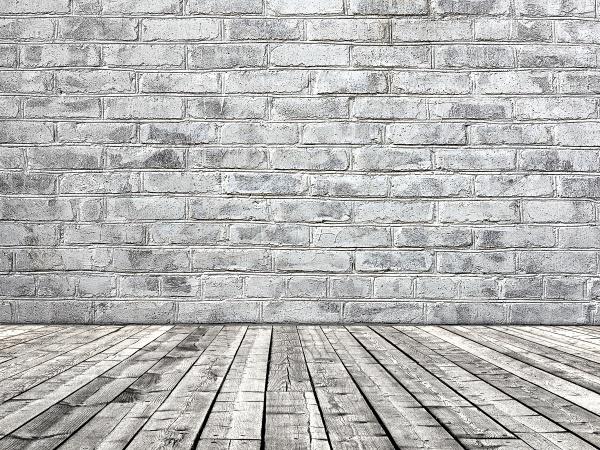 Фон кирпичной стены и деревянного пола