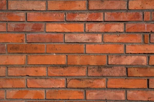Красный фон кирпичной стены
