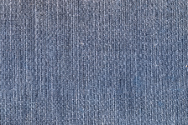 Изношенная текстура ткани с обложки книги