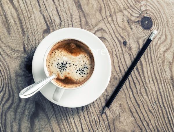 Чашка кофе и карандаш