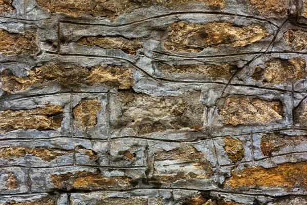 Грубая текстура каменной стены