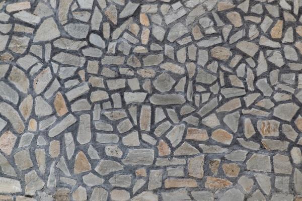 Стена забора из природного камня фон