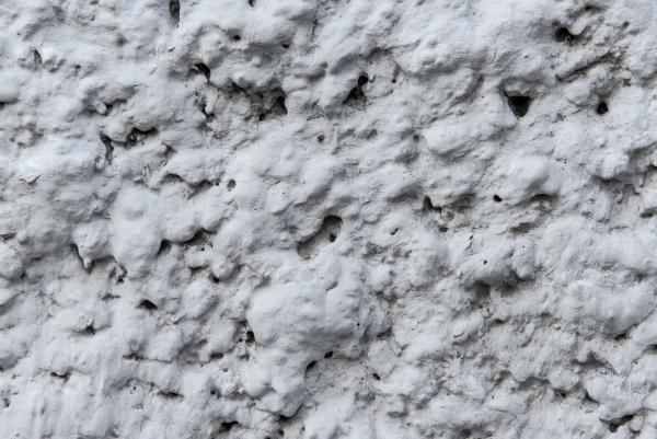 Текстура цементной облицовки на стене дома