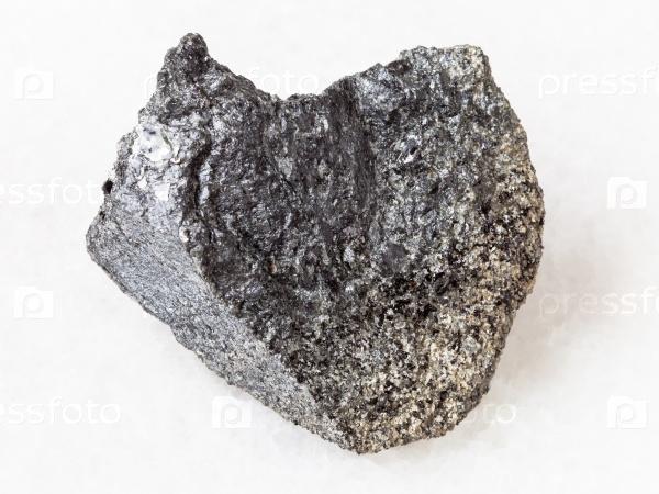 Перидотитовый камень с флогопитом на белом