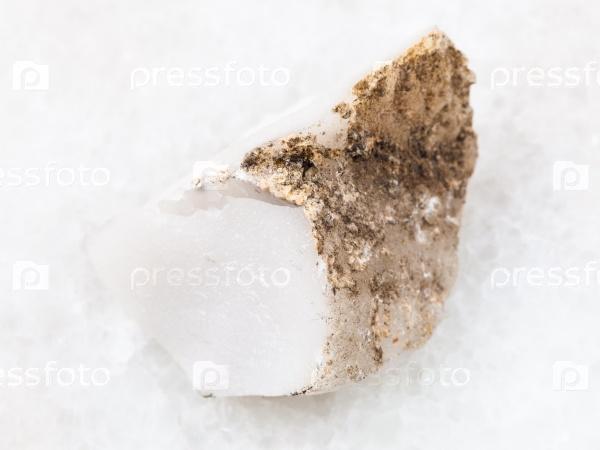 Кахолонг (белый опал) камень на белом