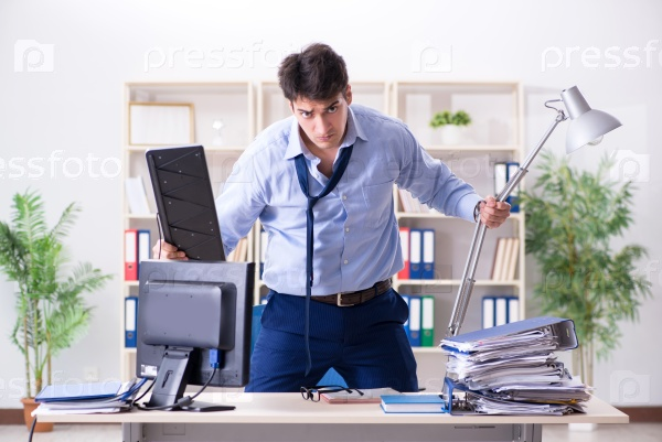 Angry businessman frustrated with too much work