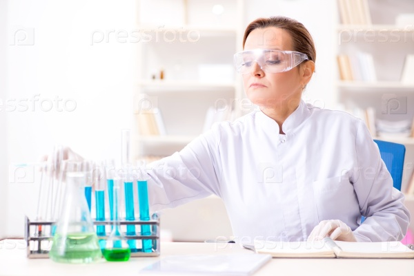 Woman chemist working in hospital clinic lab
