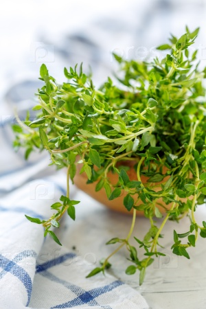 Fresh thyme in a wooden bowl.