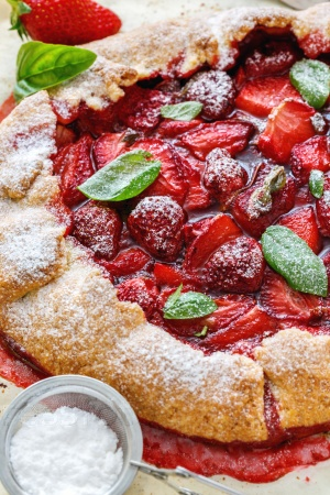 Homemade cake with strawberries and basil.