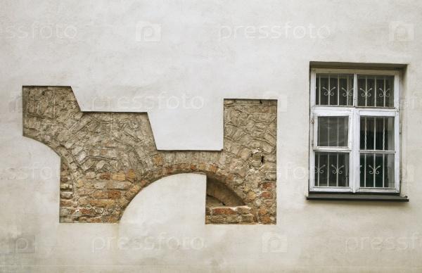 Штукатурка стена с остатками старой кладки